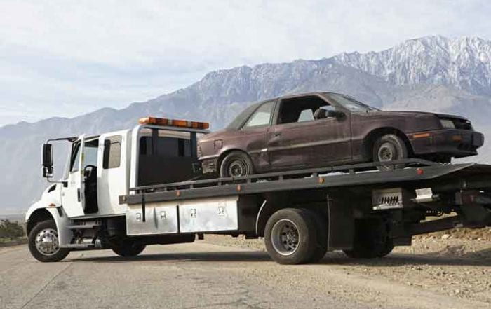 Junk Car on tow truck